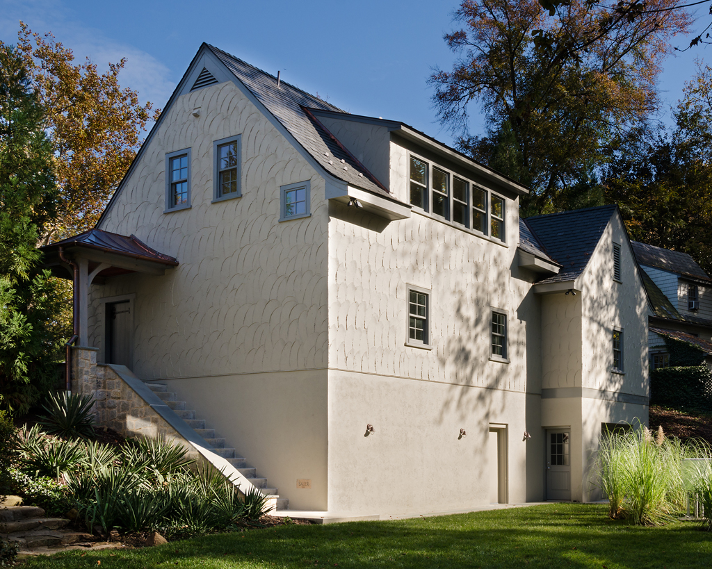 the rear elevation of the finished garage and an indication of the steep slope of