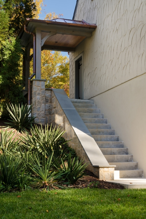 Rear stairs to garage side entrance